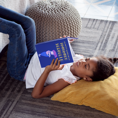 hardcover-book-mockup-featuring-a-happy-girl-reading-on-the-floor-30979